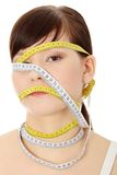 Diet. Young woman with measuring tape around her head, isolated on white. Diet concept Stock Photography