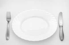 Diet. Empty plate with knife and fork Stock Photo