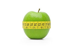 Diet. A green apple is the symbol of a good diet Royalty Free Stock Images