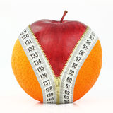 Diet. Fruits and diet against fat Stock Photography