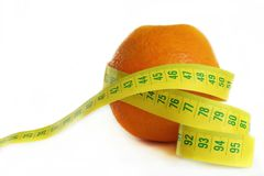 Diet. Orange with measuring tape isolated over white background Stock Photos