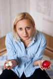 Diet. Healthy eating woman. sweets and apple Royalty Free Stock Image