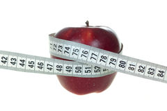 Diet. Apple and a measure tape - diet concept Royalty Free Stock Photo