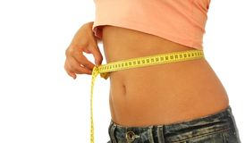 Diet. A woman measuring her belly with a measuring tape Stock Photo