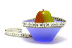 Diet. Pear with tape-measure Royalty Free Stock Images