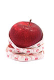 Diet. Apple and measurement on white background Royalty Free Stock Images