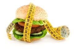 Diet. Hamburger with meter diet concept Stock Image