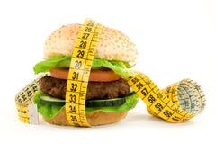 Diet. Hamburger with meter diet concept Stock Photo