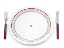Diet. Single pea on plate Stock Photos