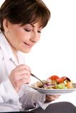 Diet. Mature woman eating salad, healthy lifestyle Stock Photos