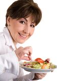 Diet. Mature woman on a diet eating salad Stock Photo