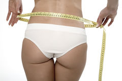 Diet. Woman misuring her small waist Stock Image