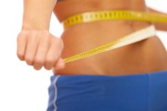 Diet?. Woman body part is being measured Royalty Free Stock Photography