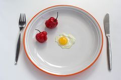 Diet. Fun diet, quail egg and hot red pepper stock images