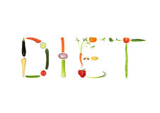 Diet. Vegetable selection spelling the words diet food, over white background Stock Images