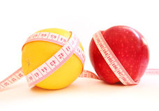 Diet. Measure tape and apple show diet Stock Photography
