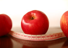 Diet. Measure tape and apple show diet Stock Photos