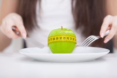 Diet. Apple and centimeter on the plate. Fitness healthy eating Royalty Free Stock Photos