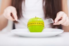 Diet. Apple and centimeter on the plate. Fitness healthy eating Stock Images