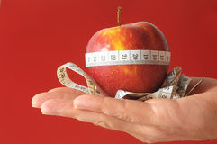 Diet Apple and Meter on the Hand Royalty Free Stock Image
