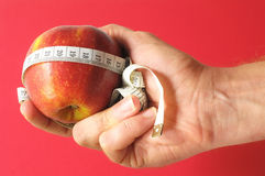 Diet Apple and Meter on the Hand Stock Photography