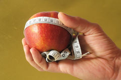 Diet Apple and Meter on the Hand Stock Image