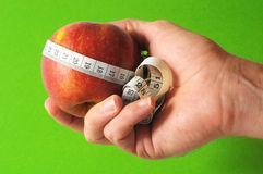 Diet Apple and Meter on the Hand Stock Photo