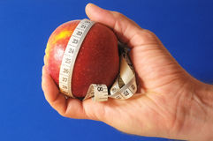 Diet Apple and Meter on the Hand Stock Photos