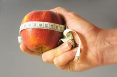 Diet Apple and Meter on the Hand Royalty Free Stock Images