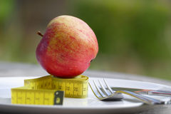Diet, apple on tape measure Royalty Free Stock Photos