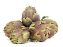 Diet_artichokes. Baby artichoke on a white surface royalty free stock images