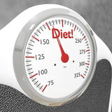 Diet bathroom scale. In close up with diet at top of scale Stock Photo