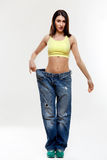 Diet. Beautiful Sporty Woman Showing How Much Weight She Lost. H Stock Photography
