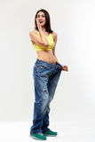 Diet. Beautiful Sporty Woman Showing How Much Weight She Lost. H Stock Images