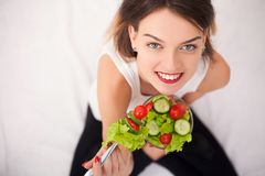 Diet. Beautiful Young Woman Eating Vegetable Salad stock photo