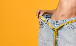 Diet, big jeans, lost weight, beautiful body, figure stock photo
