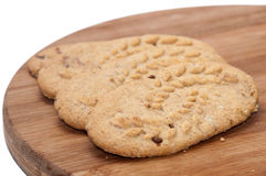 Diet biscuits with wheat on wooden board Royalty Free Stock Images
