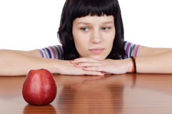 Diet boring. Attractive girl with apple making a diet boring - focus in the apple stock photography