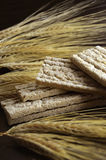 Diet bread. Iet bread and wheat ears on dark background Royalty Free Stock Photos