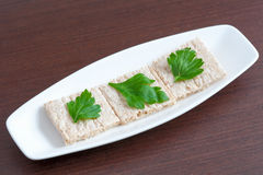 Diet bread with parsley on a plate Stock Image