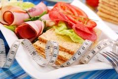 Diet breakfast. With crispbread focused on measure tape Stock Images