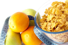 Diet breakfast. With cornflakes, orange and apples Royalty Free Stock Photography