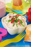 Diet breakfast for child. Bowl of cottage cheese with cream ,chives and radish as healthy diet breakfast for child Royalty Free Stock Photo
