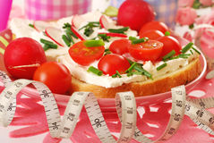 Diet breakfast and measure tape Royalty Free Stock Images