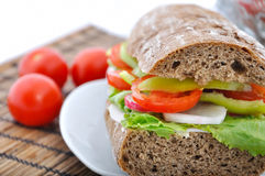 Diet brown baguette with vegetable Royalty Free Stock Photography