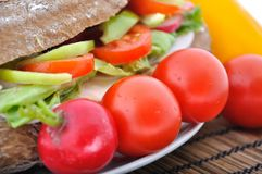 Diet brown baguette with vegetable Royalty Free Stock Images