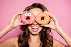 Diet, calories, healthcare, willpower, summer, body care, concep. T. Close up portrait of happy cute girl with sweet donuts like specs, laughing, so playful and Royalty Free Stock Photography
