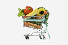 Diet and the carriage. The complete set of dietary products in the carriage from a supermarket Stock Photography