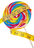Diet Challenge. Concept with Candy Lollipop and Measuring Tape.  Isolated on White with a Clipping Path Royalty Free Stock Photography