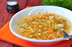Diet chicken soup, cabbage, carrots and chickpeas Royalty Free Stock Images